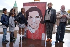 Minute de silence pour l'absent, Raif Badawi, commentée par Émile Martel et Marian Bosford Fraser et Ensaf Haidar et ses enfants, Naja, doudi et Myriam